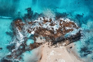 Aerial view of waves, rocks and sea