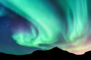 Aurora borealis and mountains