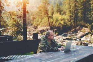 Adult forester works on netbook