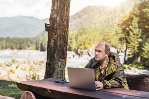 Forester with laptop outdoors
