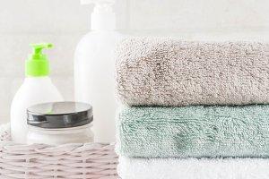 Stack bath towels & cosmetics