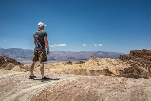 Hiker standing at Zabriskie point  in Death Valley National Park