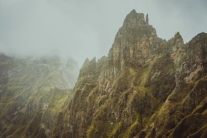 Harsh rugged mountain peaks between Xo-xo and Paul Valley overgrown with verdant grass. Santo Antao Island, Cape Verde