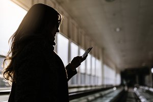 Unrecognizable woman using a mobile.