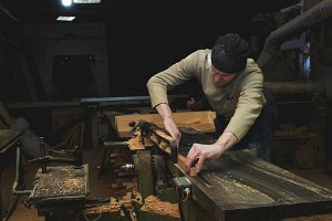 Carpenter Working on Woodworking Machines in Carpentry Shop. Male Hand Clos up.