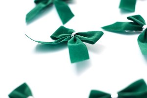 Green velvet bows on white
