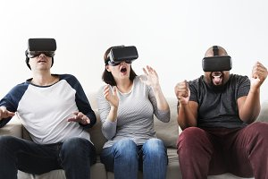 Friends enjoying VR game
