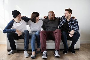 Diverse friends sitting on couch