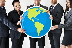 Business people holding globe icon