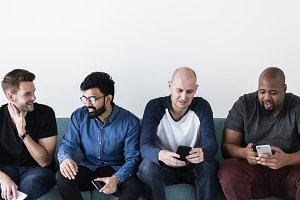 Diverse men using mobile phone