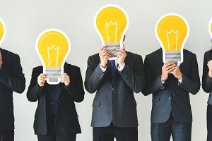 People holding lightbulb icons