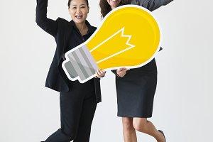 Businesswomen with lightbulb icon