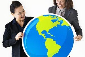 Businesswomen holding globe icon