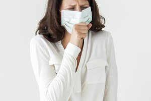 Sick woman wearing surgical mask