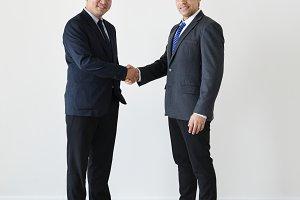 Diverse businessmen shaking hands