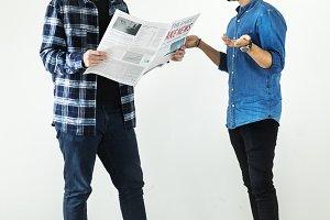 Men reading newspaper