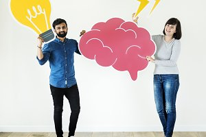 Couple holding brain and light bulb