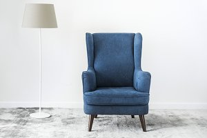 Wing back chair on a carpet