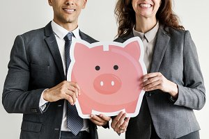 Business couple holding piggybank