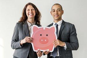 Business couple holding piggybank
