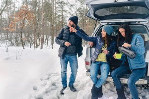 Three best friends travel in winter