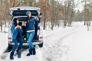 Two female friends traveling winter