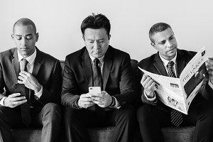 Businessmen working on phone