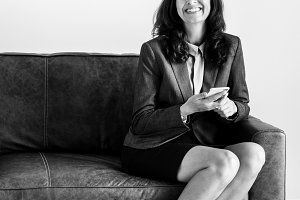 Businesswoman sitting on the couch
