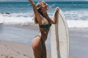Beauty girl with surfboard