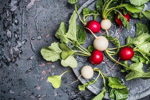 Colorful radishes on plate