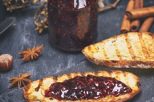 raspberry jam with a glass jar