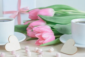 Pink tulips, coffee, wooden hearts