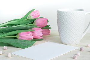 Desktop with pink tulips and mug