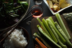 Chopsticks, rice and ingredients for making sushi are a top view. Asian cuisine