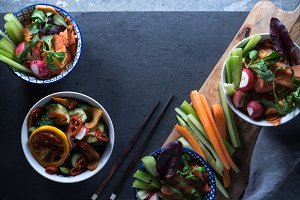 Marinated vegetables in bowls and chopsticks copy space. Asian cuisine