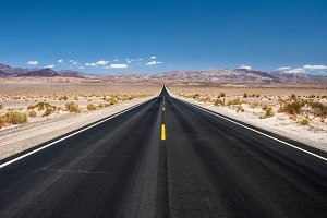 Empty road running through Death Valley National Park