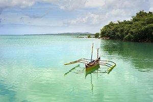 Tropical landscape & banka boat