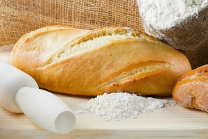 Baguette, sack of flour, rolling pin
