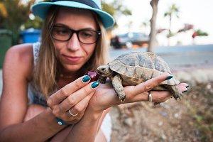 woman feeding turtle