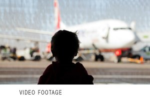 Little boy watching planes
