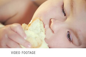 Close-up of a child eating bun