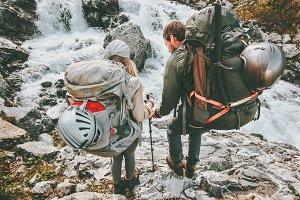 Couple backpackers friends hiking
