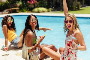 Girls having a party at poolside