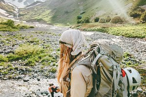 Woman hiker in mountains adventure