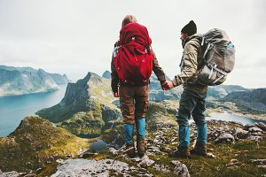 Couple backpackers holding hands