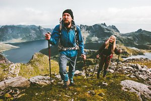 Couple travelers hiking in mountains