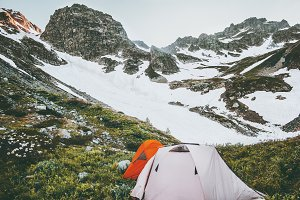 Camping tents in rocky mountains