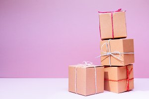 Cardboard boxes on pink background