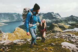 Couple backpackers hiking in Norway