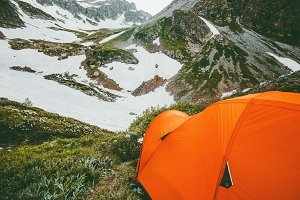 Camping tent bivouac in mountains